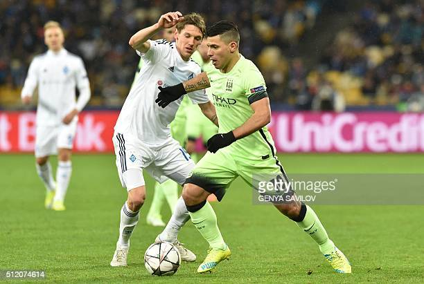 Manchester City's Argentinian forward Sergio Aguero vies with Dynamo Kiev's Ukrainian midfielder Denys Garmash during the UEFA Champions league round...