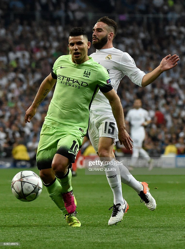 Manchester City's Argentinian forward Sergio Aguero (L) vies with Real Madrid's defender Dani Carvajal during the UEFA Champions League semi-final second leg football match Real Madrid CF vs Manchester City FC at the Santiago Bernabeu stadium in Madrid, on May 4, 2016. / AFP / GERARD