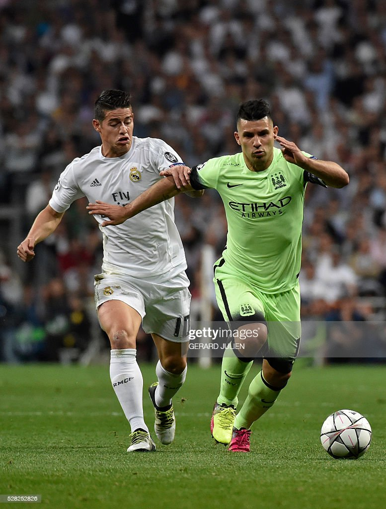 Manchester City's Argentinian forward Sergio Aguero (R) vies with Real Madrid's Colombian midfielder James Rodriguez during the UEFA Champions League semi-final second leg football match Real Madrid CF vs Manchester City FC at the Santiago Bernabeu stadium in Madrid, on May 4, 2016. / AFP / GERARD