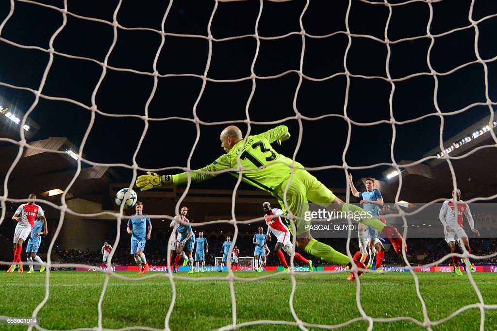 Manchester City's Argentinian goalkeeper Willy Caballero (C) concedes a goal to Monaco's French midfielder Tiemoue Bakayoko (back) during the UEFA Champions League round of 16 football match between Monaco and Manchester City at the Stade Louis II in Monaco on March 15, 2017. / AFP PHOTO / Pascal GUYOT