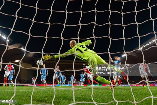 Manchester City's Argentinian goalkeeper Willy Caballero concedes a goal to Monaco's French midfielder Tiemoue Bakayoko during the UEFA Champions...