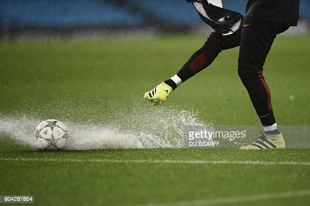 TOPSHOT Manchester CIty's Argentinian goalkeeper Willy Caballero kicks a ball on the waterlogged pitch ahead of the UEFA Champions League group C...