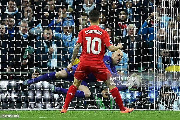 Manchester CIty's Argentinian goalkeeper Willy Caballero saves the penalty from Liverpool's Brazilian midfielder Philippe Coutinho during the penalty...