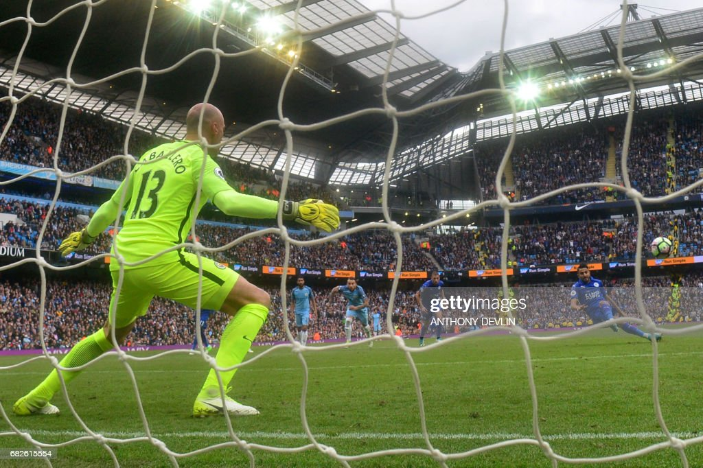 Manchester City's Argentinian goalkeeper Willy Caballero (L) stands by as Leicester City's Algerian midfielder Riyad Mahrez (R) takes his penalty, which hit his standing foot on the way to the goal, and was subsequently disallowed during the English Premier League football match between Manchester City and Leicester City at the Etihad Stadium in Manchester, north west England, on May 13, 2017. / AFP PHOTO / Anthony DEVLIN / RESTRICTED TO EDITORIAL USE. No use with unauthorized audio, video, data, fixture lists, club/league logos or 'live' services. Online in-match use limited to 75 images, no video emulation. No use in betting, games or single club/league/player publications. /