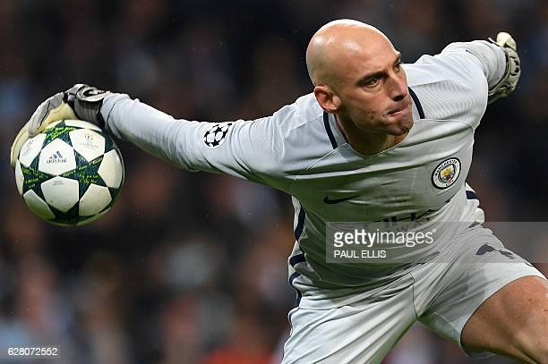 TOPSHOT Manchester CIty's Argentinian goalkeeper Willy Caballero throws the ball during the UEFA Champions League group C football match between...