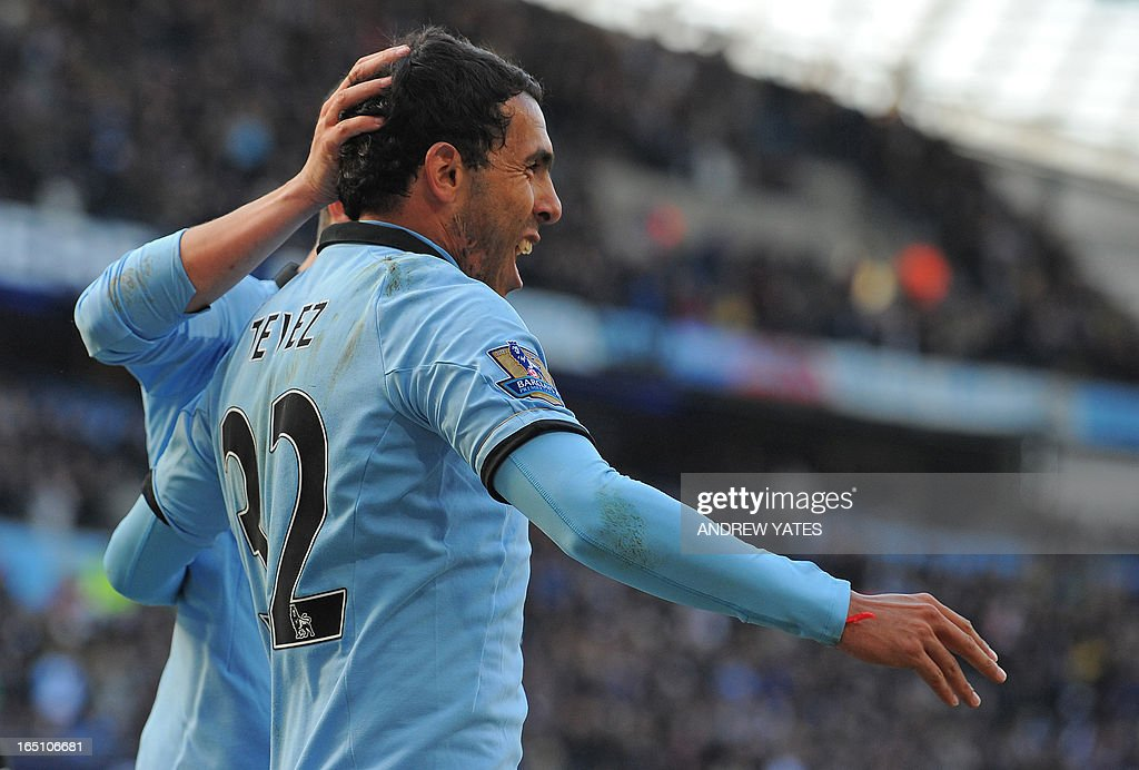 "Manchester City's Argentinian striker Carlos Tevez celebrates scoring the opening goal of the English Premier League football match between Manchester City and Newcastle United at the Etihad Stadium in Manchester, northwest England, on March 30, 2013. USE. No use with unauthorized audio, video, data, fixture lists, club/league logos or ""live"" services. Online in-match use limited to 45 images, no video emulation. No use in betting, games or single club/league/player publications. """