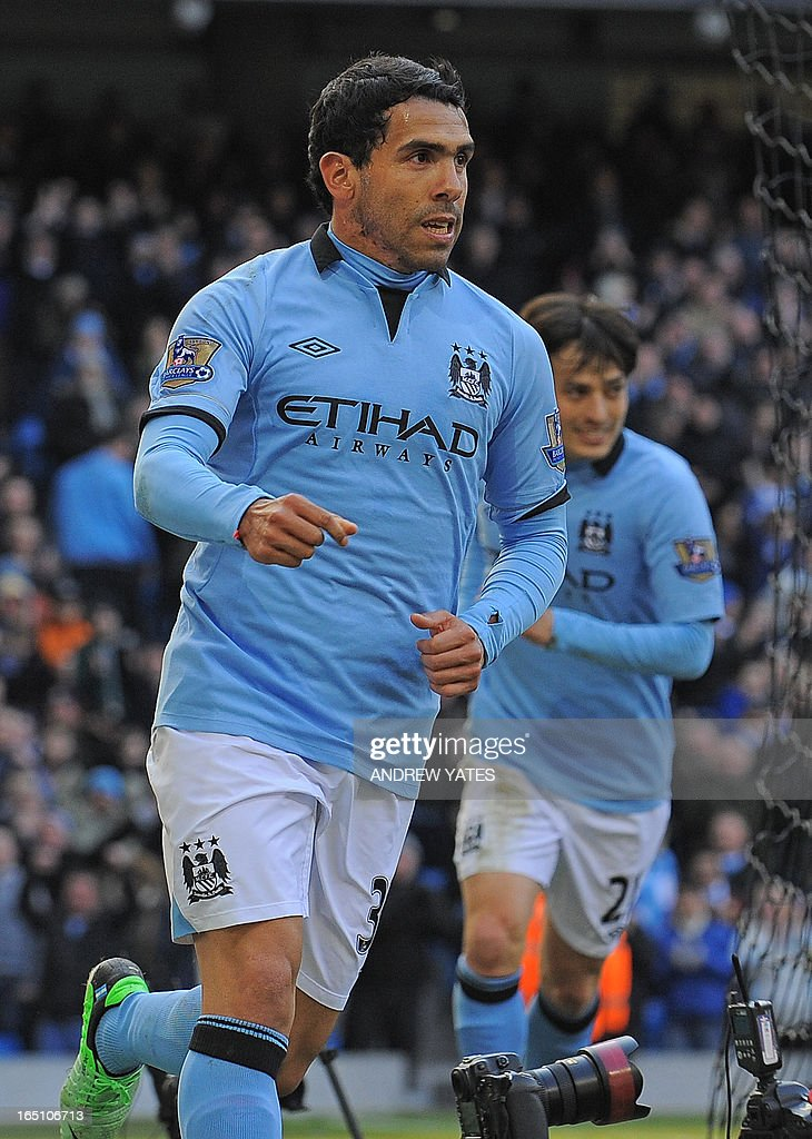 "Manchester City's Argentinian striker Carlos Tevez celebrates scoring the opening goal of the English Premier League football match between Manchester City and Newcastle United at the Etihad Stadium in Manchester, northwest England, on March 30, 2013. AFP PHOTO/ANDREW YATES USE. No use with unauthorized audio, video, data, fixture lists, club/league logos or ""live"" services. Online in-match use limited to 45 images, no video emulation. No use in betting, games or single club/league/player publications. """