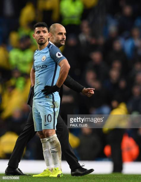 Manchester City's Argentinian striker Sergio Aguero and Manchester City's Spanish manager Pep Guardiola react after the English Premier League...