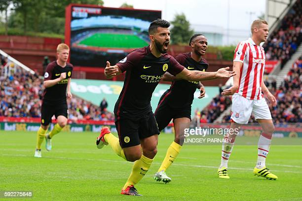 Manchester City's Argentinian striker Sergio Aguero celebrates after scoring the opening goal from the penalty spot during the English Premier League...