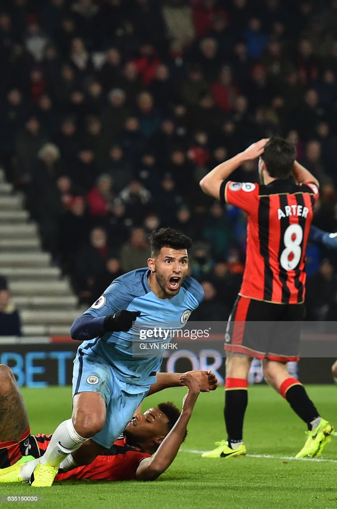Manchester City's Argentinian striker Sergio Aguero (L) celebrates after scoring their second goal during the English Premier League football match between Bournemouth and Manchester City at the Vitality Stadium in Bournemouth, southern England on February 13, 2017. / AFP / Glyn KIRK / RESTRICTED TO EDITORIAL USE. No use with unauthorized audio, video, data, fixture lists, club/league logos or 'live' services. Online in-match use limited to 75 images, no video emulation. No use in betting, games or single club/league/player publications. /