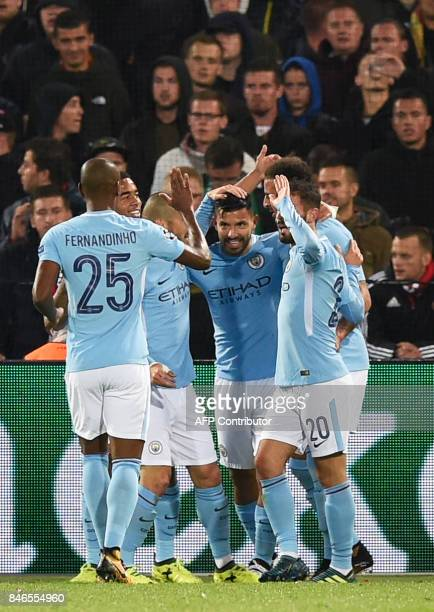 Manchester City's Argentinian striker Sergio Aguero celebrates teammates after scoring a goal during the UEFA Champions League Group F football match...