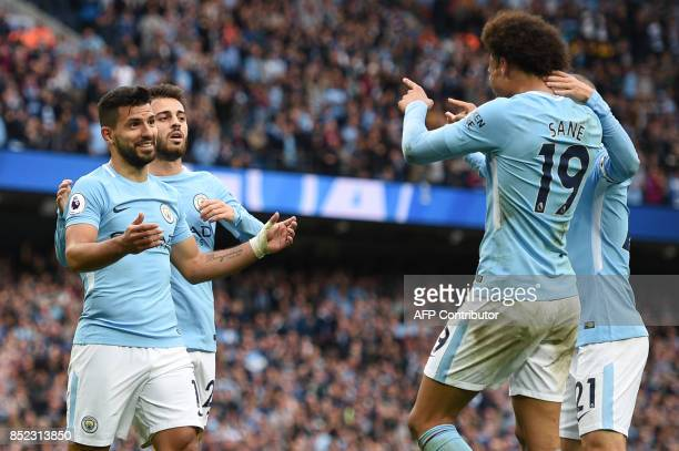 Manchester City's Argentinian striker Sergio Aguero celebrates after scoring with Manchester City's German midfielder Leroy Sane during the English...
