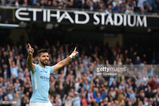 Manchester City's Argentinian striker Sergio Aguero celebrates after scoring their fourth goal during the English Premier League football match...