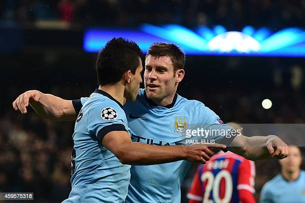 Manchester City's Argentinian striker Sergio Aguero celebrates scoring the opening goal from a penalty kick with Manchester City's English midfielder...