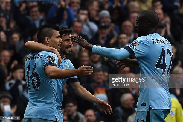 Manchester City's Argentinian striker Sergio Aguero celebrates scoring their second goal with Manchester City's Spanish midfielder Jesus Navas and...