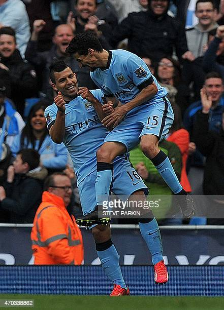 Manchester City's Argentinian striker Sergio Aguero celebrates scoring their second goal with Manchester City's Spanish midfielder Jesus Navas during...