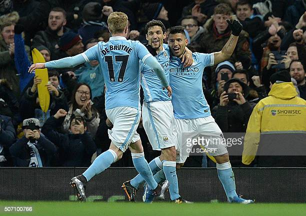 Manchester City's Argentinian striker Sergio Aguero celebrates scoring his team's second goal during the English League Cup semifinal second leg...