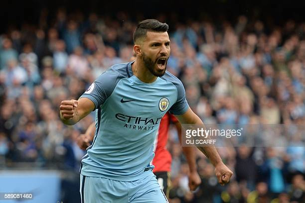 Manchester City's Argentinian striker Sergio Aguero celebrates scoring the opening goal from the penalty spot during the English Premier League...