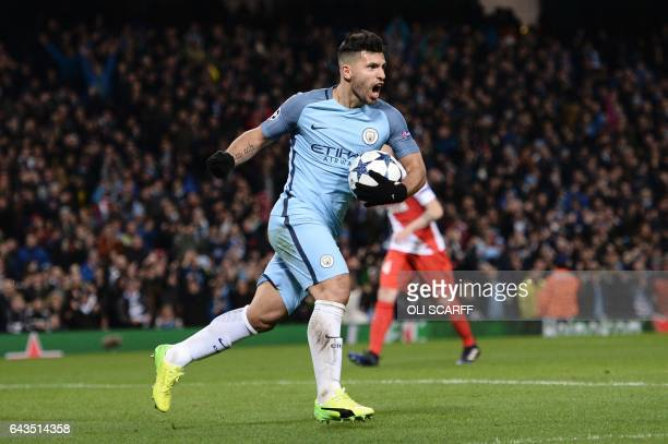 Manchester City's Argentinian striker Sergio Aguero celebrates scoring their second goal during the UEFA Champions League Round of 16 firstleg...