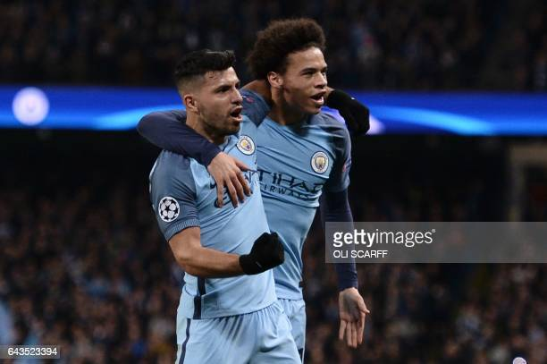 Manchester City's Argentinian striker Sergio Aguero celebrates scoring their second goal with Manchester City's German midfielder Leroy Sane during...