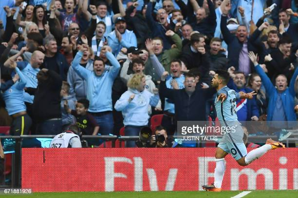 Manchester City's Argentinian striker Sergio Aguero celebrates scoring the opening goal during the FA Cup semifinal football match between Arsenal...