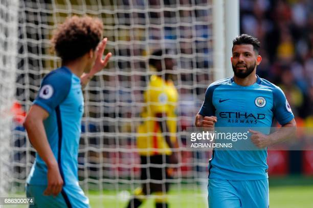 Manchester City's Argentinian striker Sergio Aguero celebrates scoring his team's third goal with Manchester City's German midfielder Leroy Sane...