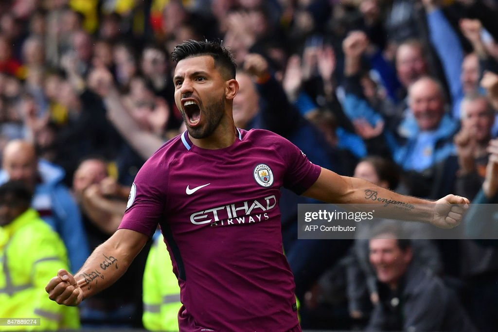 TOPSHOT - Manchester City's Argentinian striker Sergio Aguero celebrates scoring his third and the team's fifth goal during the English Premier League football match between Watford and Manchester City at Vicarage Road Stadium in Watford, north of London on September 16, 2017. / AFP PHOTO / Ben STANSALL / RESTRICTED TO EDITORIAL USE. No use with unauthorized audio, video, data, fixture lists, club/league logos or 'live' services. Online in-match use limited to 75 images, no video emulation. No use in betting, games or single club/league/player publications. /