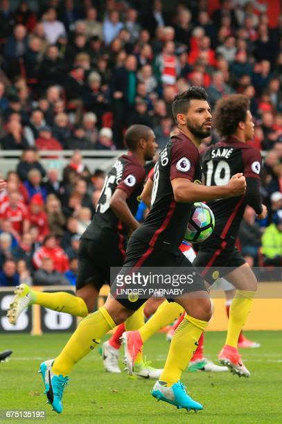 Manchester City's Argentinian striker Sergio Aguero celebrates the oneall equaliser goal from a penalty during the English Premier League football...