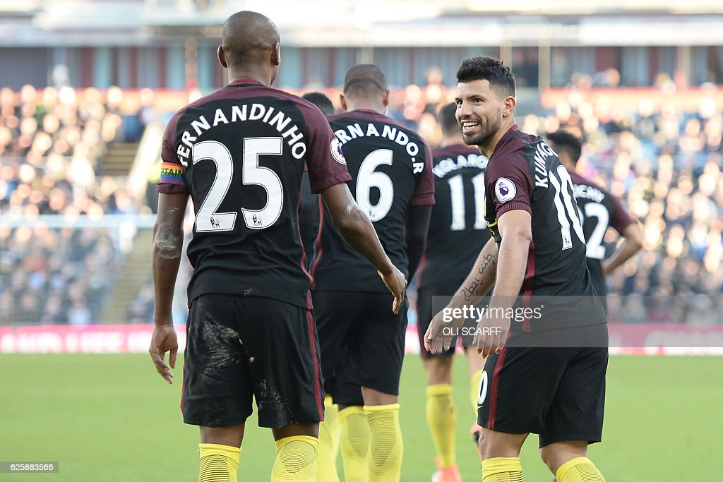 Manchester City's Argentinian striker Sergio Aguero (R) celebrates with teammates after scoring their second goal during the English Premier League football match between Burnley and Manchester City at Turf Moor in Burnley, north west England on November 26, 2016. / AFP / Oli SCARFF / RESTRICTED TO EDITORIAL USE. No use with unauthorized audio, video, data, fixture lists, club/league logos or 'live' services. Online in-match use limited to 75 images, no video emulation. No use in betting, games or single club/league/player publications. /