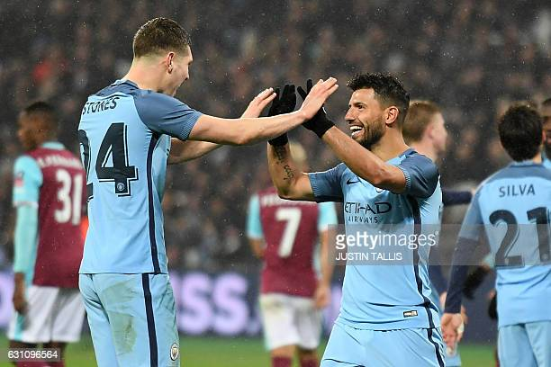 Manchester City's Argentinian striker Sergio Aguero celebrates with Manchester City's English defender John Stones after scoring their fourth goal...