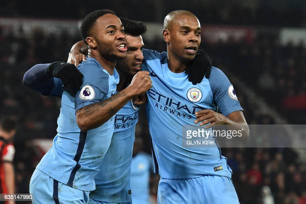 Manchester City's Argentinian striker Sergio Aguero celebrates with Manchester City's English midfielder Raheem Sterling and Manchester City's...