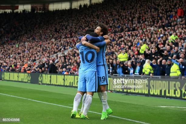 Manchester City's Argentinian striker Sergio Aguero celebrates with teammates after scoring their second goal during the English FA cup quarter final...