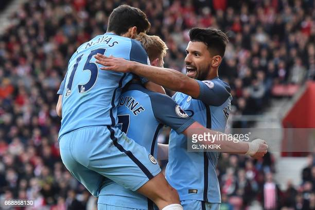 Manchester City's Argentinian striker Sergio Aguero celebrates with teammates after scoring their third goal during the English Premier League...