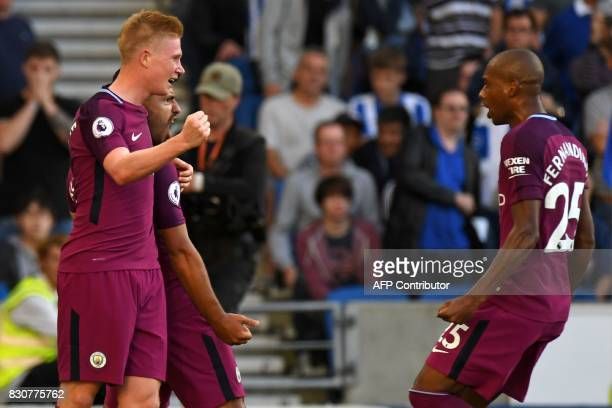 Manchester City's Argentinian striker Sergio Aguero celebrates with Manchester City's Belgian midfielder Kevin De Bruyne and Manchester City's...