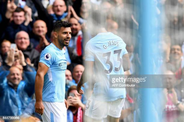 Manchester City's Argentinian striker Sergio Aguero celebrates with Manchester City's Brazilian striker Gabriel Jesus after scoring the opening goal...