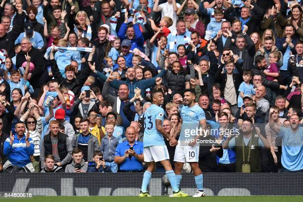 Manchester City's Argentinian striker Sergio Aguero celebrates with Manchester City's Brazilian striker Gabriel Jesus in front of the City fans after...