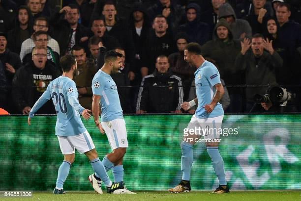Manchester City's Argentinian striker Sergio Aguero celebrates with Manchester City's Portuguese midfielder Bernardo Silva L0 and Manchester City's...