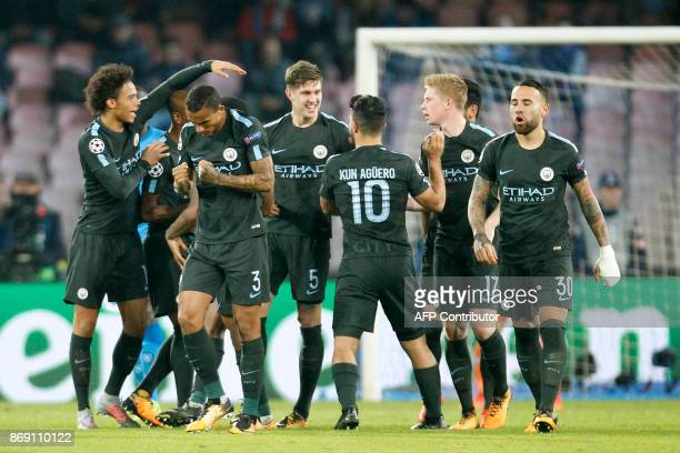 Manchester City's Argentinian striker Sergio Aguero celebrates with teammates after scoring during the UEFA Champions League football match Napoli vs...