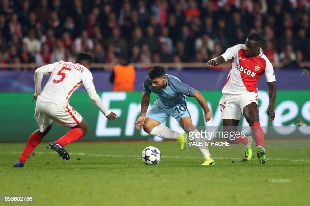 Manchester City's Argentinian striker Sergio Aguero challenges Monaco's Brazilian defender Jemerson and Monaco's French defender Benjamin Mendy...