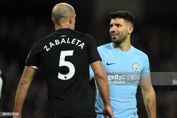 Manchester City's Argentinian striker Sergio Aguero chats with West Ham United's Argentinian defender Pablo Zabaleta during the English Premier...