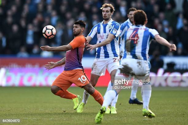 Manchester City's Argentinian striker Sergio Aguero controls the ball during the English FA Cup fifth round football match between Huddersfield Town...