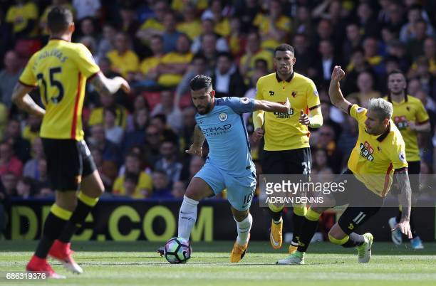 Manchester City's Argentinian striker Sergio Aguero controls the ball during the English Premier League football match between Watford and Manchester...
