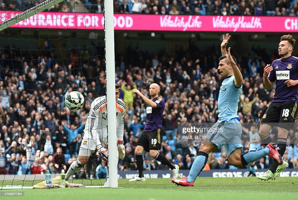 Manchester City's Argentinian striker Sergio Aguero (2R) follows up as the ball bounces into the goal after a big deflection off West Ham United's Welsh defender <a gi-track='captionPersonalityLinkClicked' href=/galleries/search?phrase=James+Collins+-+Futbolista+gal%C3%A9s&family=editorial&specificpeople=15167252 ng-click='$event.stopPropagation()'>James Collins</a> (2L) for a West Ham own goal to open the scoring during the English Premier League football match between Manchester City and West Ham United at the Etihad Stadium in Manchester, north west England on April 19, 2015. AFP PHOTO / PAUL ELLIS USE. No use with unauthorized audio, video, data, fixture lists, club/league logos or live services. Online in-match use limited to 45 images, no video emulation. No use in betting, games or single club/league/player publications.