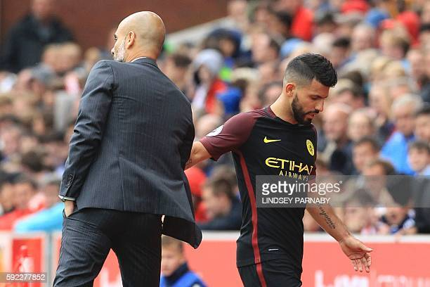 Manchester City's Argentinian striker Sergio Aguero gestures to Manchester City's Spanish manager Pep Guardiola as he's substituted during the...