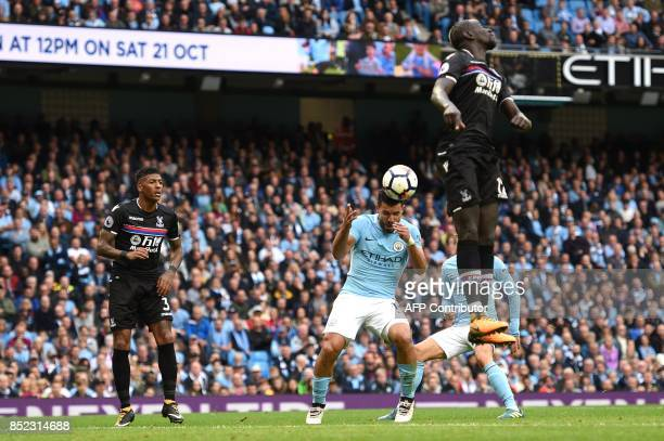 Manchester City's Argentinian striker Sergio Aguero heads the ball to score their fourth goal during the English Premier League football match...