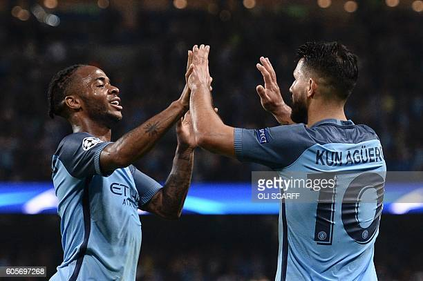 Manchester City's Argentinian striker Sergio Aguero is congratulated by Manchester City's English midfielder Raheem Sterling after scoring their...
