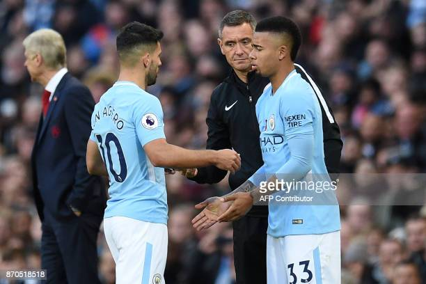 Manchester City's Argentinian striker Sergio Aguero is substituted for Manchester City's Brazilian striker Gabriel Jesus during the English Premier...