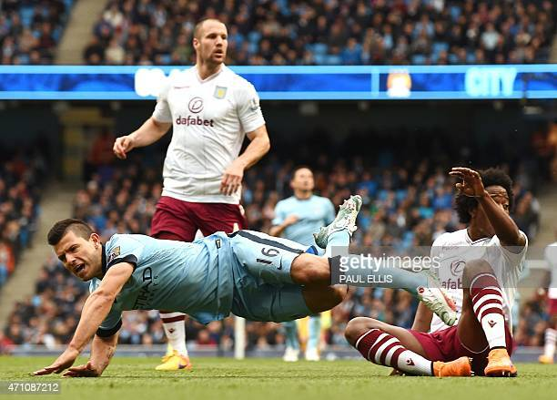 Manchester City's Argentinian striker Sergio Aguero is tackled by Aston Villa's Colombian midfielder Carlos Sanchez during the English Premier League...