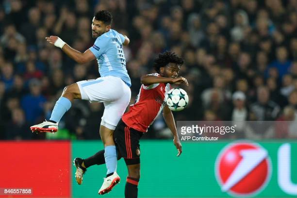 Manchester City's Argentinian striker Sergio Aguero jumps for the ball with Feyenoord's Dutch defender Miquel Nelom during the UEFA Champions League...
