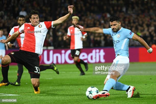 Manchester City's Argentinian striker Sergio Aguero kicks the ball during the UEFA Champions League Group F football match between Feyenoord...